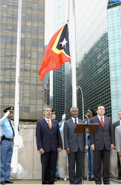 Timor-Leste Becomes 191st State to Join United Nations: The flag of Timor-Leste is raised to join those of other Member States in a special ceremony to mark the occasion at United Nations Headquarters.  Left and center are Kay Rala Xanana Gusmão, President of the Democratic Republic of Timor-Leste, and Secretary-General Kofi Annan.  September 27, 2002. UN Photo